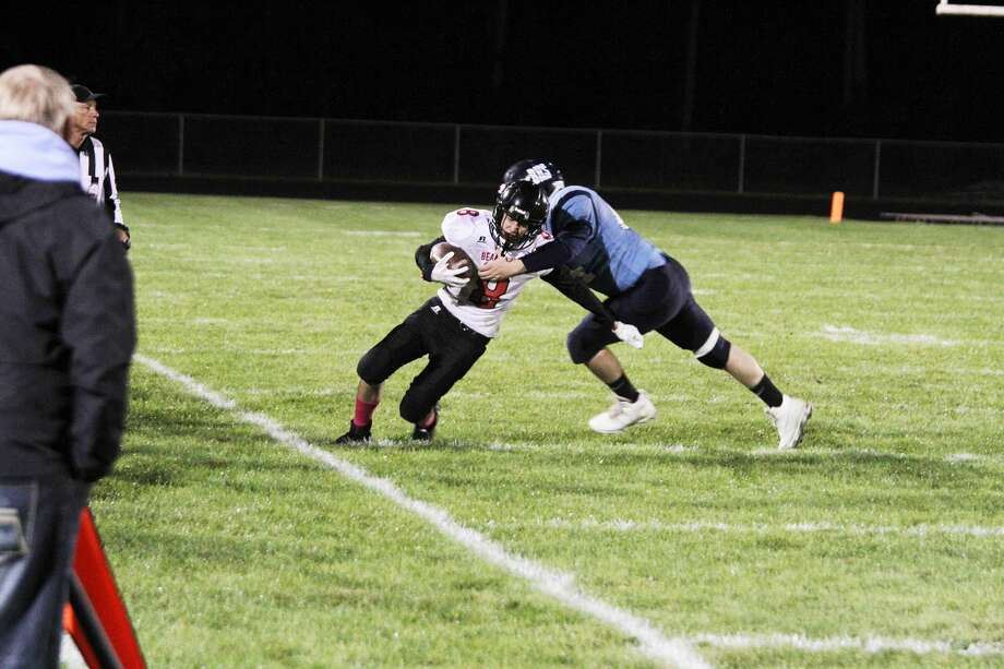 Bear Lake's Tate Aultman fights for yardage against Brethren. The Lakers will host league-leading Mesick on Friday. (News Advocate file photo) Photo: News Advocate File Photo