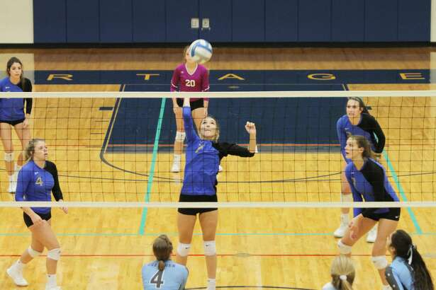 Onekama's Sydnee Hrachovina elevates for a spike during Wednesday's sweep of Brethren.