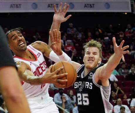 Houston Rockets Thabo Sefolosha looks to get the ball past San Antonio Spurs Jakob Poeltlduring the second half of NBA game at Toyota Center Wednesday, Oct. 16, 2019, in Houston.