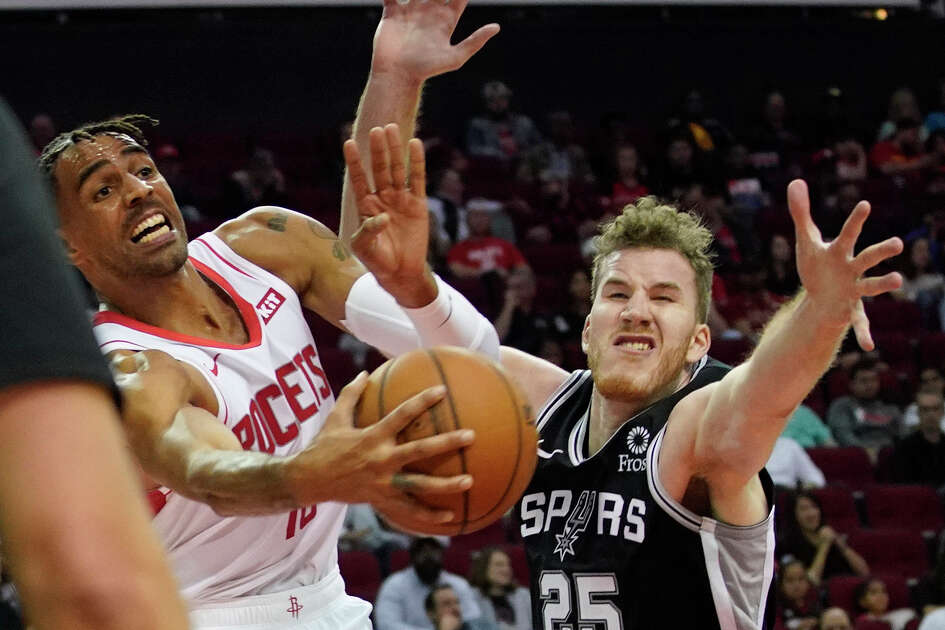 Houston Rockets Thabo Sefolosha looks to get the ball past San Antonio Spurs Jakob Poeltlduring the second half of NBA game at Toyota Center Wednesday, Oct. 16, 2019, in Houston.