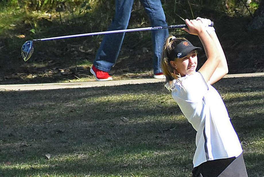 Edwardsville sophomore Grace Daech watches her tee shot during the Class 2A O'Fallon Sectional. Photo: Matt Kamp|The Intelligencer