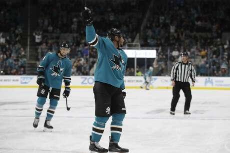 San Jose Sharks' Evander Kane, center, celebrates his goal against the Carolina Hurricanes during the first period of an NHL hockey game Wednesday, Oct. 16, 2019, in San Jose, Calif. (AP Photo/Ben Margot)