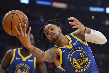 Golden State Warriors guard D'Angelo Russell reaches for a ball as it goes out of bounds during the first half of the team's preseason NBA basketball game against the Los Angeles Lakers on Wednesday, Oct. 16, 2019, in Los Angeles. (AP Photo/Mark J. Terrill)