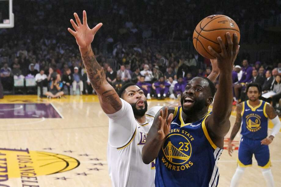 Golden State Warriors forward Draymond Green shoots as Los Angeles Lakers forward Anthony Davis defends during the first half of a preseason NBA basketball game Wednesday, Oct. 16, 2019, in Los Angeles. Photo: Mark J. Terrill, Associated Press