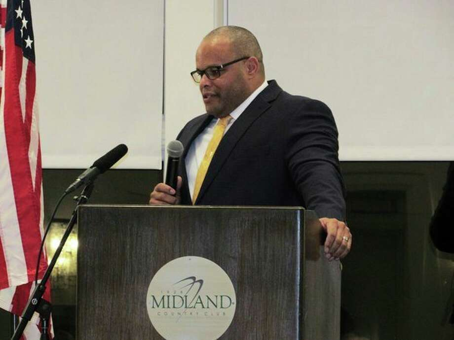 "Sgt. Corey Armstead of the Midland Police Department accepts a ""Police and Firefighters of the Year"" award at the Midland Country Club. (Mitchell Kukulka/Mitchell.Kukulka@mdn.net)"