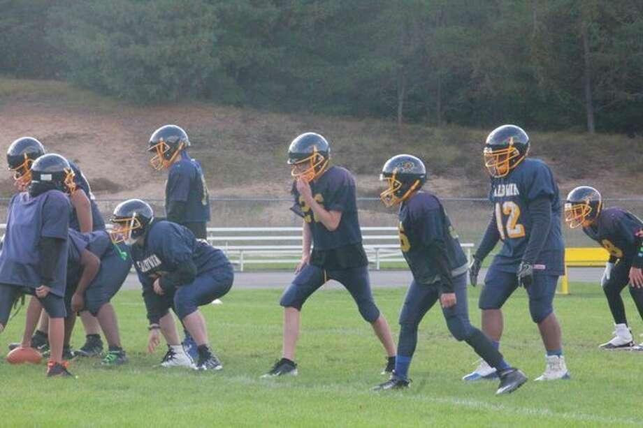 The Baldwin junior high football team goes through practice drills on Monday. (Star photo/John Raffel)