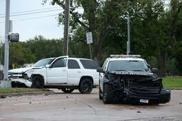 Traffic on South Braeswood Boulevard westbound is blocked due to a two-vehicle crash involving a police patrol SUV on Thursday, Oct. 17, in Houston. Two people were taken to the hospital in unknown condition.