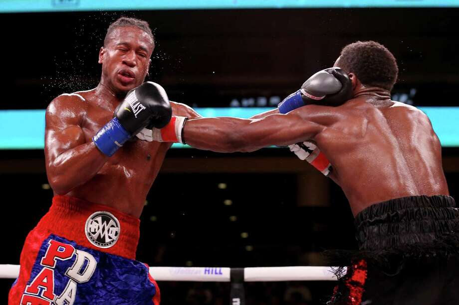CHICAGO, ILLINOIS - OCTOBER 12:  Patrick Day (L) and Charles Conwell exchange punches in the seventh round of their Super-Weltereight bout at Wintrust Arena on October 12, 2019 in Chicago, Illinois. Photo: Dylan Buell, Getty Images / 2019 Getty Images