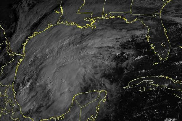 A satellite image shows a disturbance off the northeast coast of Mexico that is expected to form into a tropical storm.