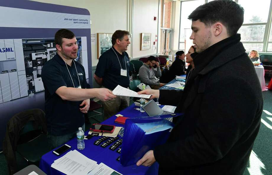 Norwalk Community College student Abdrew Dumond, right, chats with ASML Recruiter Ken Brew during NCC's Career Expo Tuesday, February 26, 2019, in the West Campus Cafeteria and Culinary Arts Dining Room at Norwalk Community College in Norwalk, Conn. Photo: Erik Trautmann / Hearst Connecticut Media / Norwalk Hour