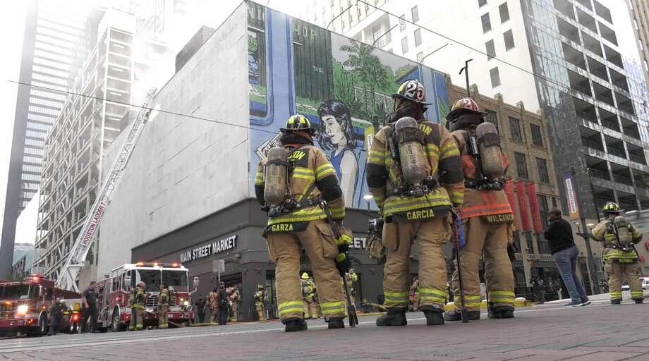 Houston firefighters battle a multi-alarm fire at the Main Street Market at 901 Main Street in downtown Houston on Thursday, Oct. 17, 2019. Photo: Jay R. Jordan / Houston Chronicle