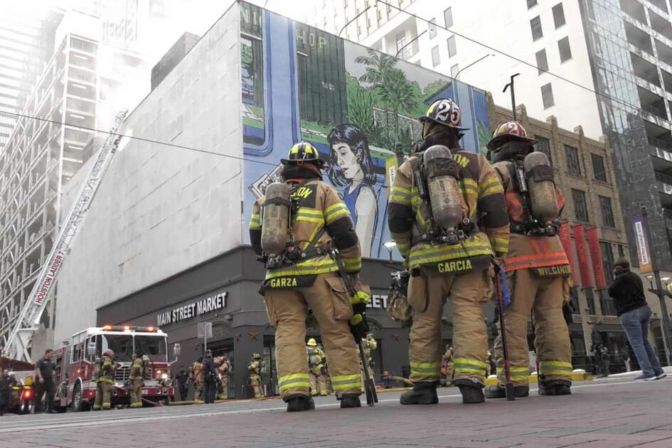 Houston firefighters battle a multi-alarm fire at the Main Street Market at 901 Main Street in downtown Houston on Thursday, Oct. 17, 2019.