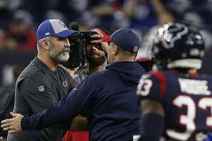 HOUSTON, TEXAS - JANUARY 05: Head coach Frank Reich of the Indianapolis Colts walks to shake hands with head coach Bill O'Brien of the Houston Texans after defeating them 21-7  during the Wild Card Round at NRG Stadium on January 05, 2019 in Houston, Texas. (Photo by Bob Levey/Getty Images)