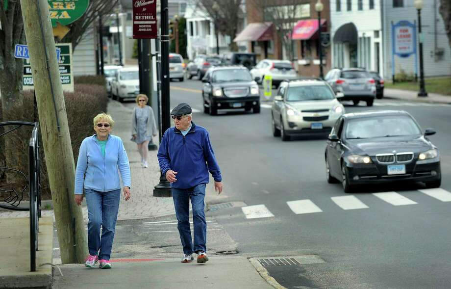 Betty and Don Campbell of Bethel take a walk on Greenwood Avenue in Bethel Thursday, March 17, 2016. Photo: Carol Kaliff / Hearst Connecticut Media / The News-Times