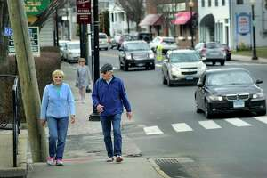 Betty and Don Campbell of Bethel take a walk on Greenwood Avenue in Bethel Thursday, March 17, 2016.