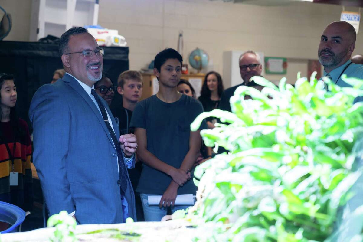 CT Commissioner of Education Miguel Cardona inspects the greenhouse in the SIS School of Innovation.