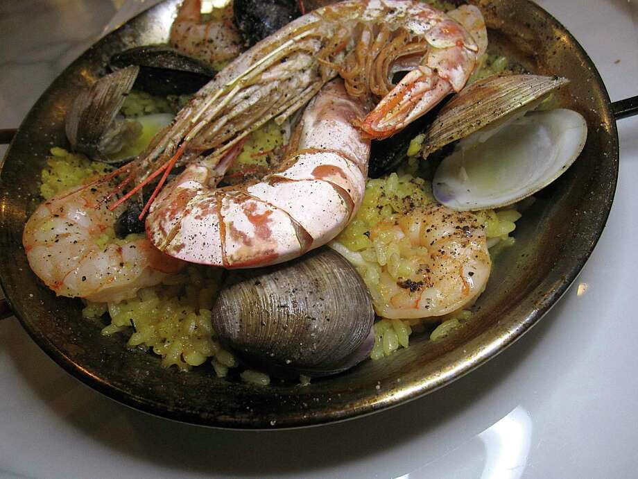 Seafood paella for two includes shrimp, mussels and clams at Savor Bistro. Photo: Mike Sutter /Staff