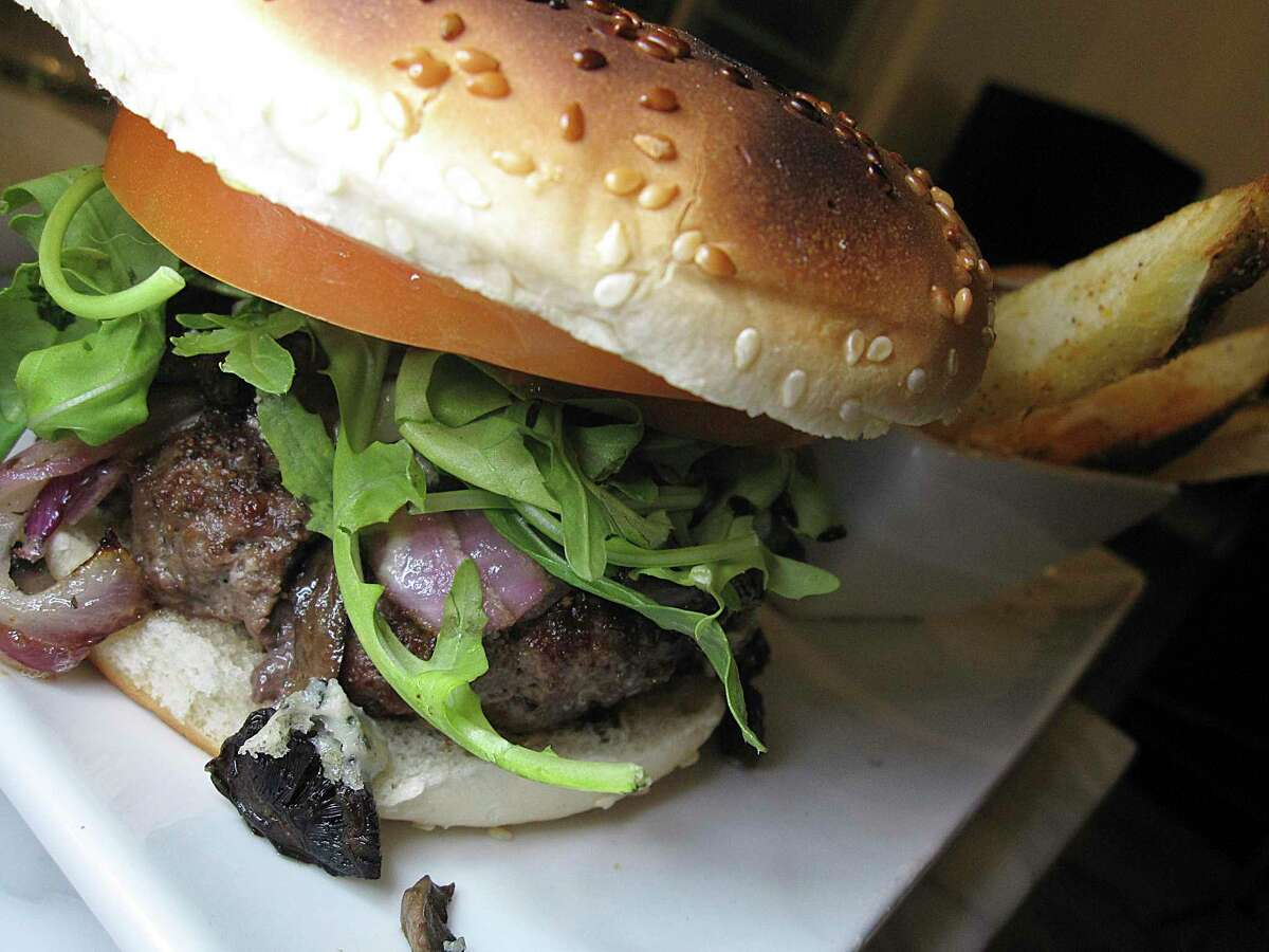 The Savor Burger comes with caramelized onions, Gorgonzola cheese, mushrooms and french fries at Savor Bistro.