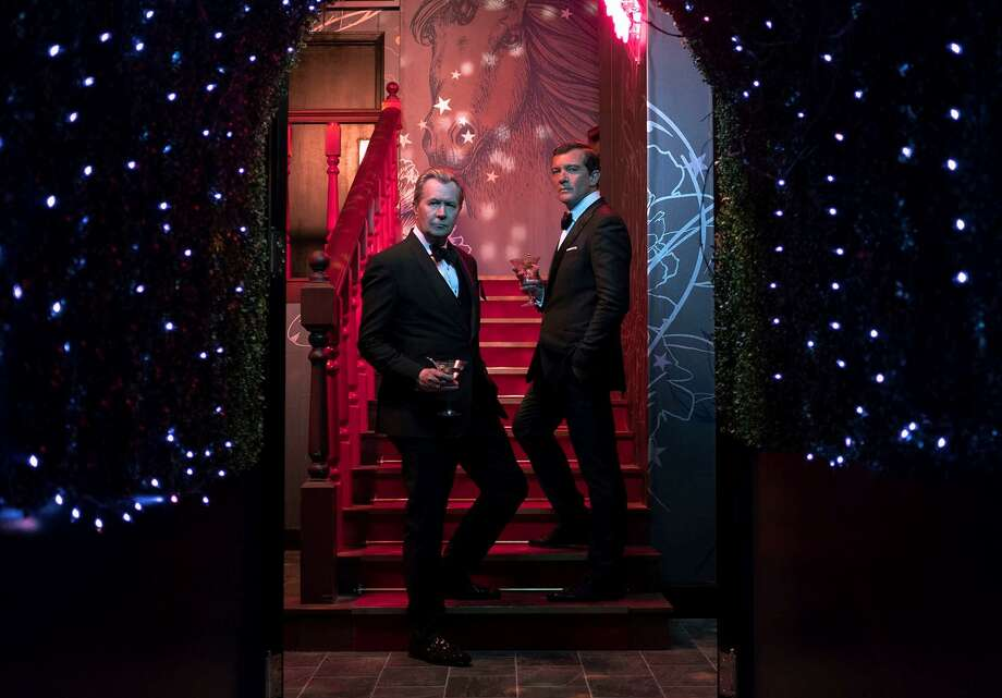 "Gary Oldman (left) and Antonio Banderas star inSteven Soderbergh's Netflix film ""The Laundromat."" Photo: Netflix / Claudette Barius/Netflix / DSCF7759"