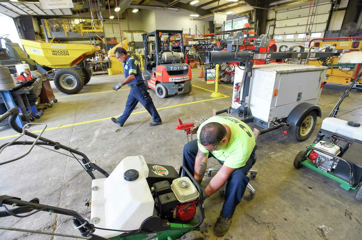 Shop Foreman Joe Skarad completes a small engine service in the repair shop at United Rentals depot at 224 Selleck Street in Stamford, Connecticut on Sept. 12, 2019.