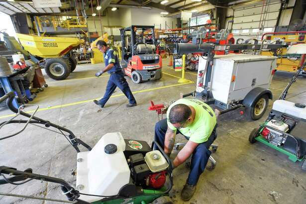 Shop Foreman Joe Skarad completes a small engine service in the repair shop at United Rentals depot at 224 Selleck St., in Stamford, Conn., on Sept. 12, 2019.