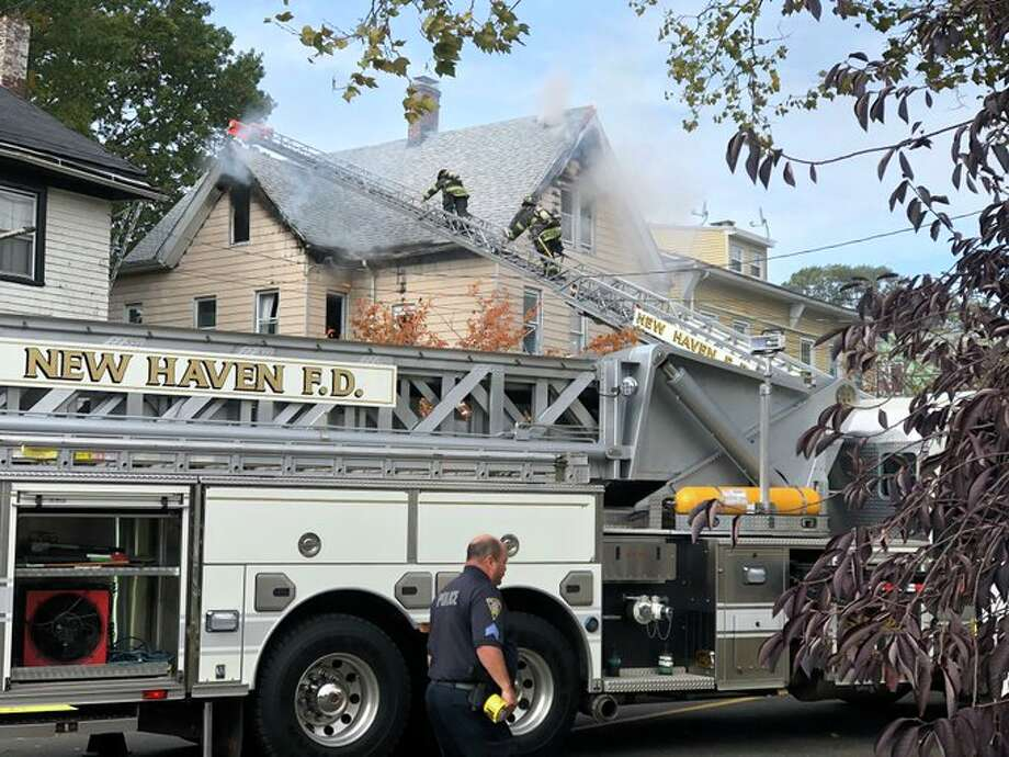 A fire on Hallock Avenue Photo: Ben Lambert