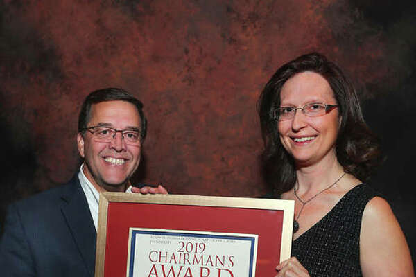 Dr. Laura Hill, right, accepts Alton Memorial Hospital's 2019 Chairman's Award from Steve Thompson, chairman of the AMH board of directors.
