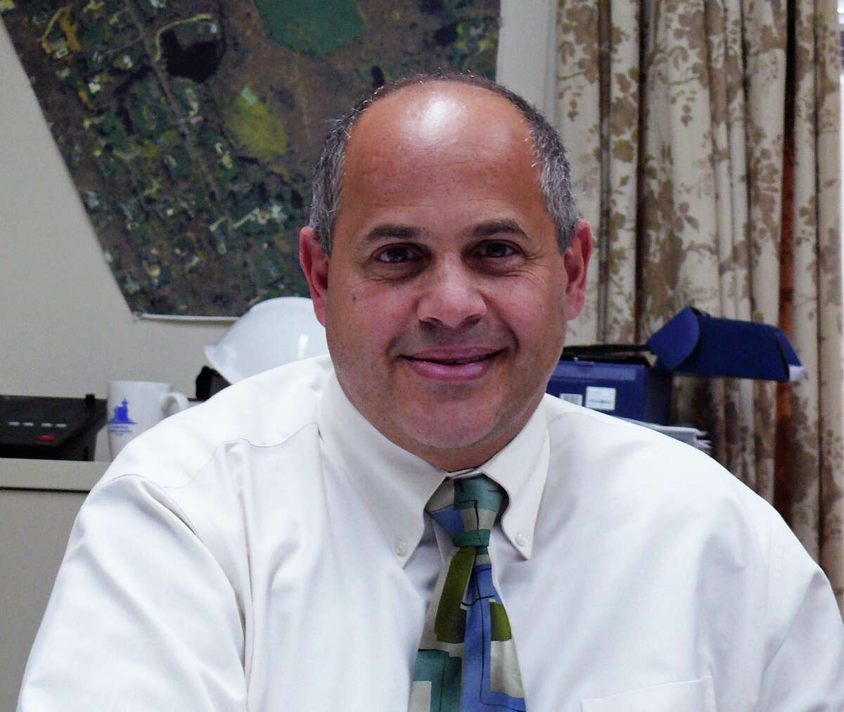 Former Fairfield Public Works Director Joseph Michelangelo faces criminal charges in fill pile scandal.