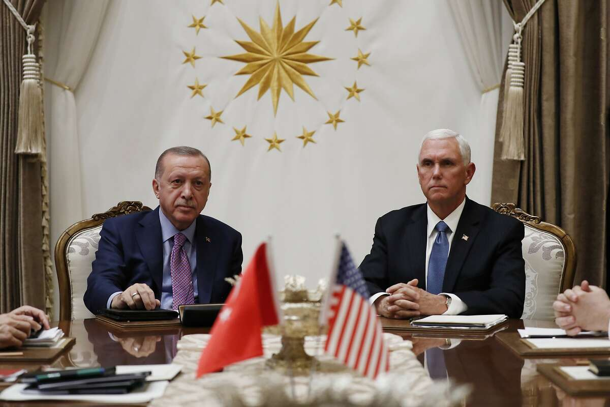 Vice President Mike Pence meets with Turkish President Recep Tayyip Erdogan at the Presidential Palace for talks on the Kurds and Syria, Thursday, Oct. 17, 2019, in Ankara, Turkey. (AP Photo/Jacquelyn Martin)