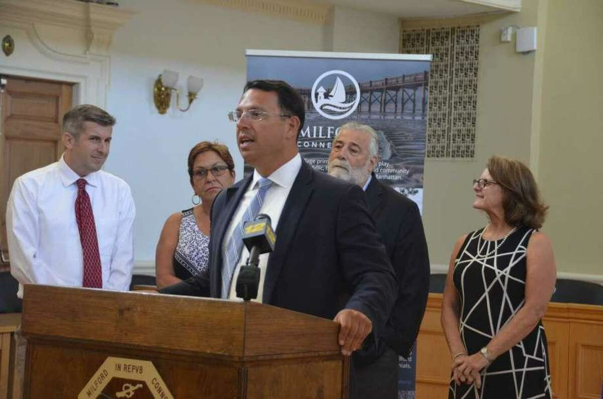 In this file photo, Milford Mayor Ben Blake announces at a press conference in that the city has met the state requirements for a moratorium on affordable housing developments allowed under the state's 8-30g housing statute.