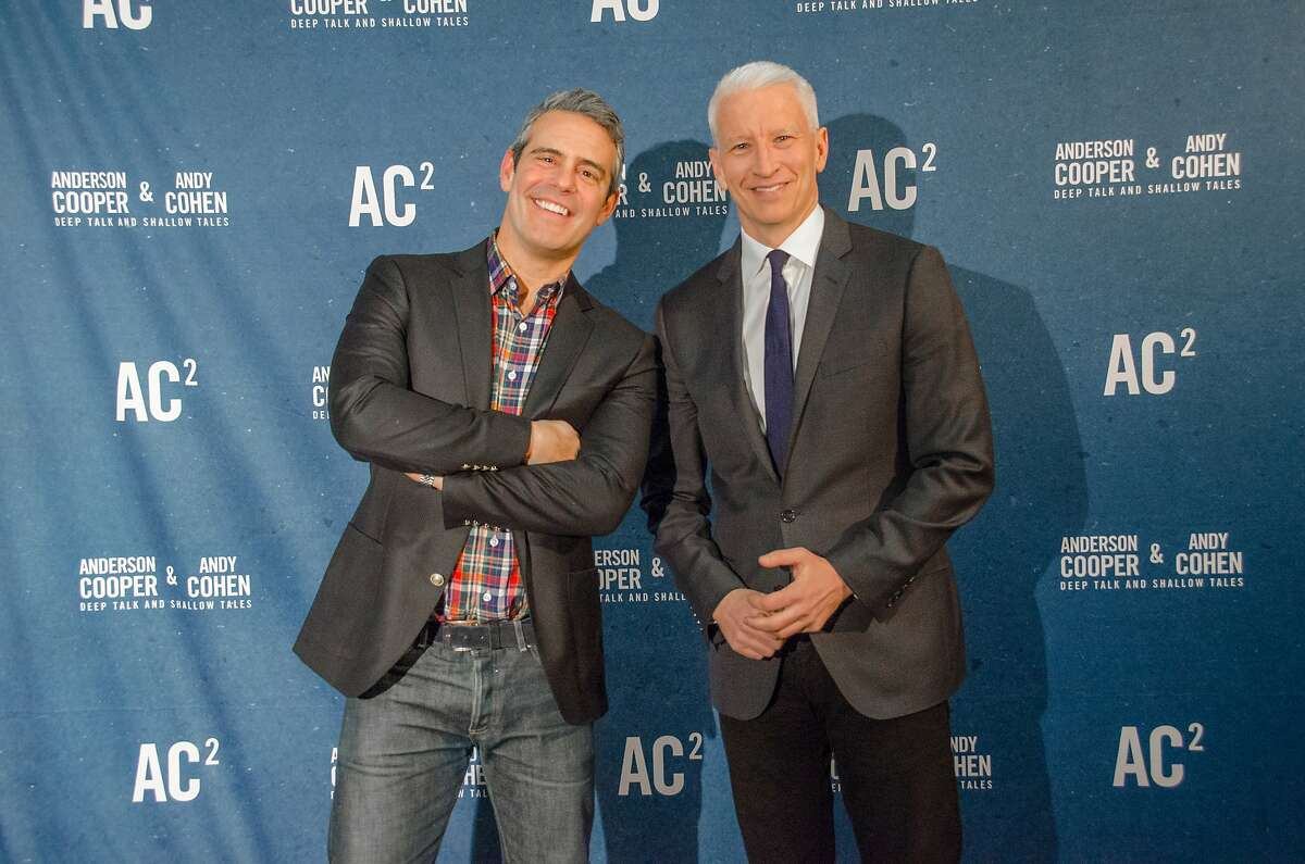 Andy Cohen, left, and Anderson Cooper onstage for AC2 Live.