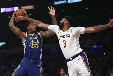 LOS ANGELES, CALIFORNIA - OCTOBER 16:  Anthony Davis #3 of the Los Angeles Lakers defends against Marquese Chriss #32 of the Golden State Warriors during the first half of a game at Staples Center on October 16, 2019 in Los Angeles, California. (Photo by Sean M. Haffey/Getty Images)