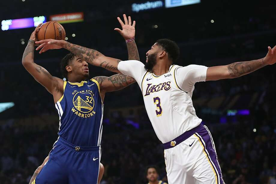 Anthony Davis defends against the Warriors' Marquese Chriss during the first half of a game at Staples Center on October 16, 2019, in Los Angeles. The Warriors waived Chriss after Monday's loss to the Sacramento Kings. Photo: Sean M. Haffey / Getty Images
