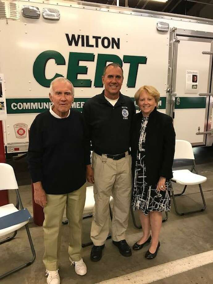 From left, CERT members Jack Majesky and T.G. Rawlins with First Selectwoman Lynne Vanderslice at a party recognizing Rawlins for 15 years of service as he leaves Wilton, on Oct. 16. Photo: Contributed Photo / Tom Gunther / Wilton Bulletin Contributed