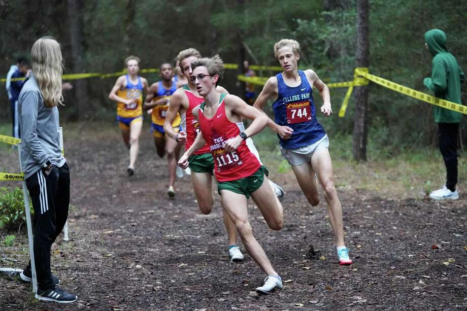 Spencer Cardinal of The Woodlands (1115) and Nicklaus Brawner of College Park (744) finished first and second, respectively, at the District 15-6A championships at College Park High School on Thursday. Photo: Ted Bell / Contributor