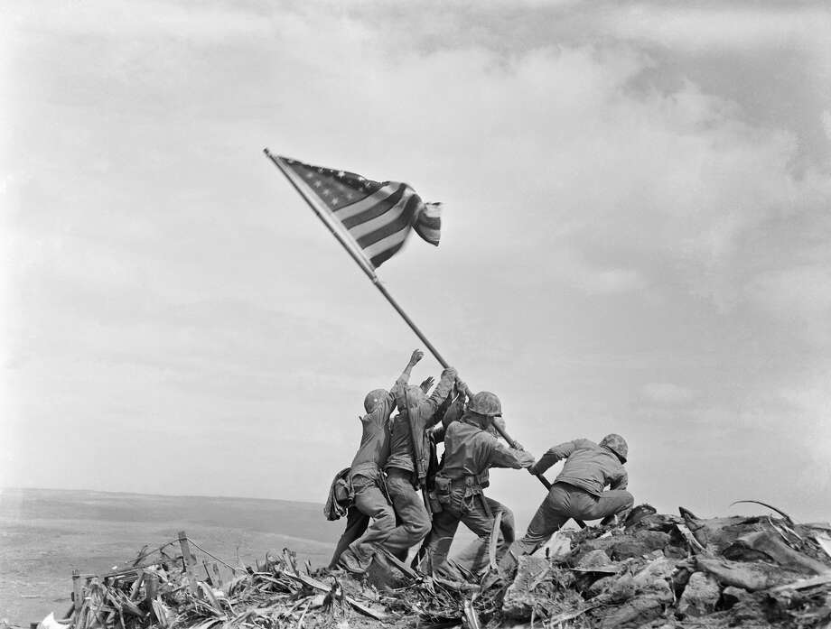 The Marine Corps has corrected the identify of another of the men who were photographed Feb. 23, 1945, raising the American flag atop Mount Suribachi, Iwo Jima, Japan, during World War II. The Marines said Thursday that after questions were raised by private historians who studied photos and films, it determined that Cpl. Harold P. Keller was among the six men who raised the flag. The Marines say Pfc. Rene Gagnon had helped in the effort but for decades was mistakenly identified by the Marines as one of the flag-raisers Photo: Joe Rosenthal/AP / Copyright 2017 The Associated Press. All rights reserved.