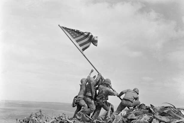 The Marine Corps has corrected the identify of another of the men who were photographed Feb. 23, 1945, raising the American flag atop Mount Suribachi, Iwo Jima, Japan, during World War II. The Marines said Thursday that after questions were raised by private historians who studied photos and films, it determined that Cpl. Harold P. Keller was among the six men who raised the flag. The Marines say Pfc. Rene Gagnon had helped in the effort but for decades was mistakenly identified by the Marines as one of the flag-raisers