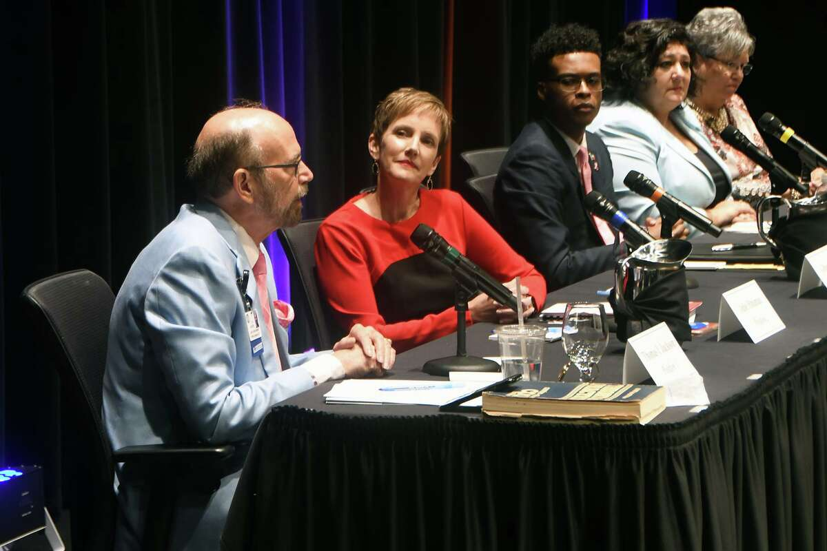 Tom Jackson, running unopposed for position 1 on the Cy-Fair ISD board of trustees, answers a question alongside Julie Hinamin, Ryan C. Irving, Natalie Blasingame and Debbie Blackshear during the candidate forum.