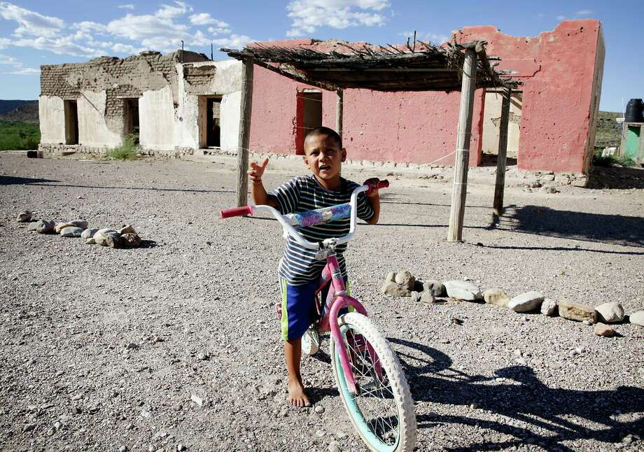 "A young boy in his hometown of Boquillas del Carmen explains the name of the nearby river is ""Rio Gringo."" Photo: Bob Owen, Staff Photographer / ©2019 San Antonio Express-News"