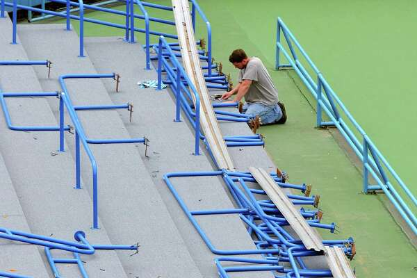 Peter Casolino - Register Installer Rob Torres works on replacing railings after installing all-weather carpeting in the Connecticut Tennis Center stadium court as workers were busy preparing for the upcoming New Haven Open at Yale. Torres works for Sullivan and Son Carpeting out of Hamden. The tennis tournament runs from runs from August 16 - 24. pcasolino@newhavenregister.com