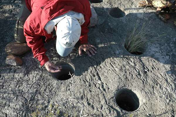 Mauricio Morales of Mexico Verde inspects what is believed to be holes made to store water in the Maderas del Carmen.