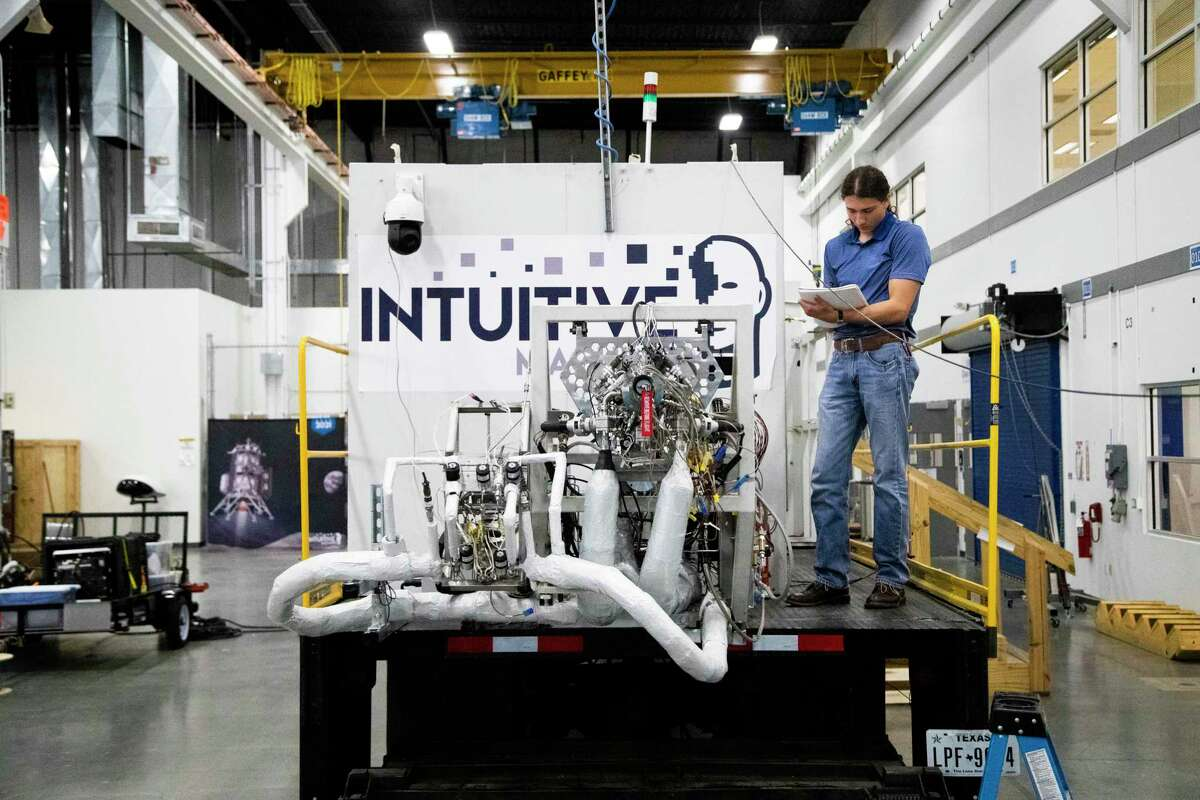Mitchell Jefferies works on a liquid oxygen main engine on a mobile test stand at Intuitive Machines in Clear Lake.