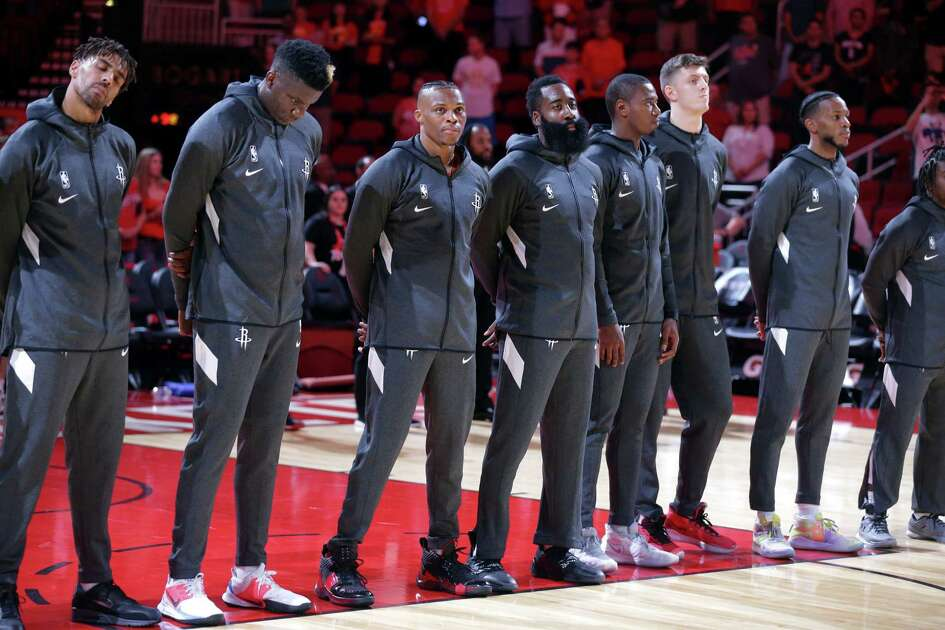 HOUSTON, TEXAS - SEPTEMBER 30: Houston Rockets during the National Anthem before playing the Shanghai Sharks at Toyota Center on September 30, 2019 in Houston, Texas. NOTE TO USER: User expressly acknowledges and agrees that, by downloading and/or using this photograph, user is consenting to the terms and conditions of the Getty Images License Agreement.