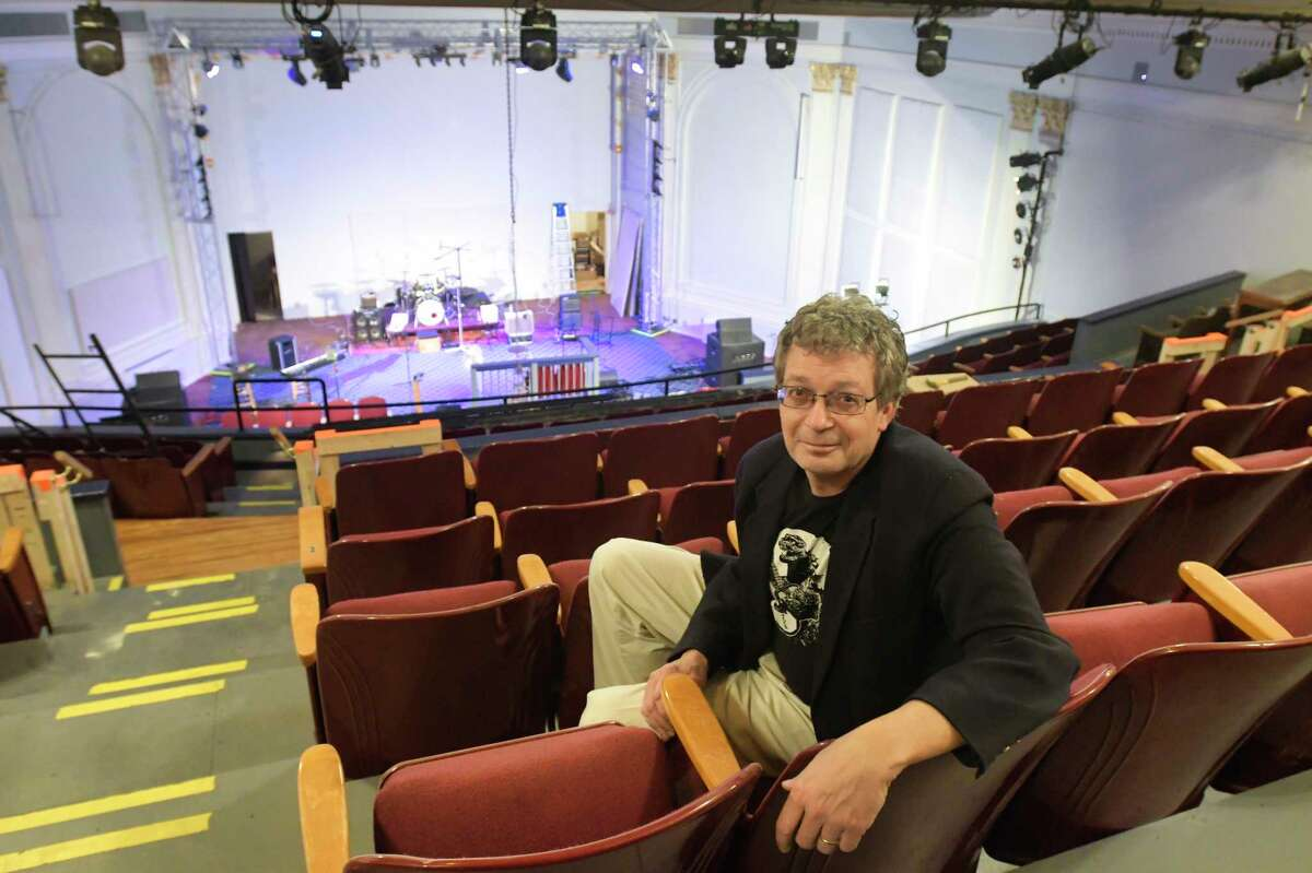 Jonathan Newell, founder and executive and artistic director of the Hudson River Music Hall Productions Inc., sits in the balcony inside the Hudson River Music Hall Strand Theatre on Thursday, Oct. 17, 2019, in Hudson Falls, N.Y. The building was last used as the Kingsbury Town Hall before the Hudson River Music Hall Productions Inc. purchased the building. (Paul Buckowski/Times Union)
