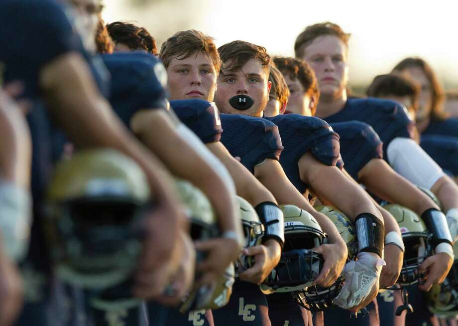 Lake Creek players are seen as the national anthem plays before a District 10-5A high school football game at Montgomery ISD Stadium, Thursday, Sept. 26, 2019, in Montgomery. Photo: Jason Fochtman, Houston Chronicle / Staff Photographer / Houston Chronicle