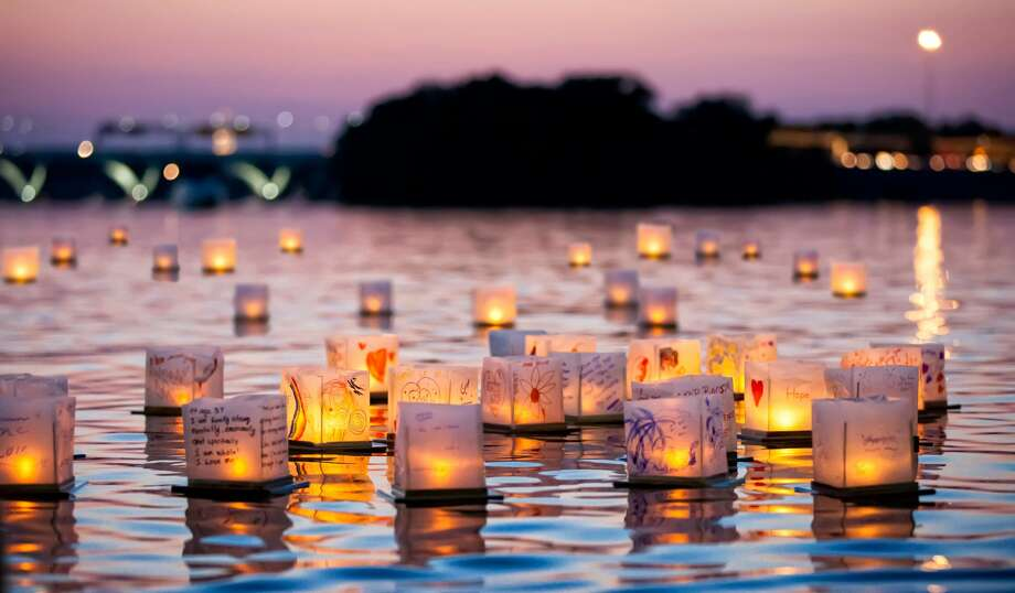 Thousands of twinkling lanterns will be released into the San Jacinto River during the Houston Water Lantern Festival set for this weekend at Magnolia Garden Park in northeast Houston. Photo: Courtesy The Water Lantern Festival