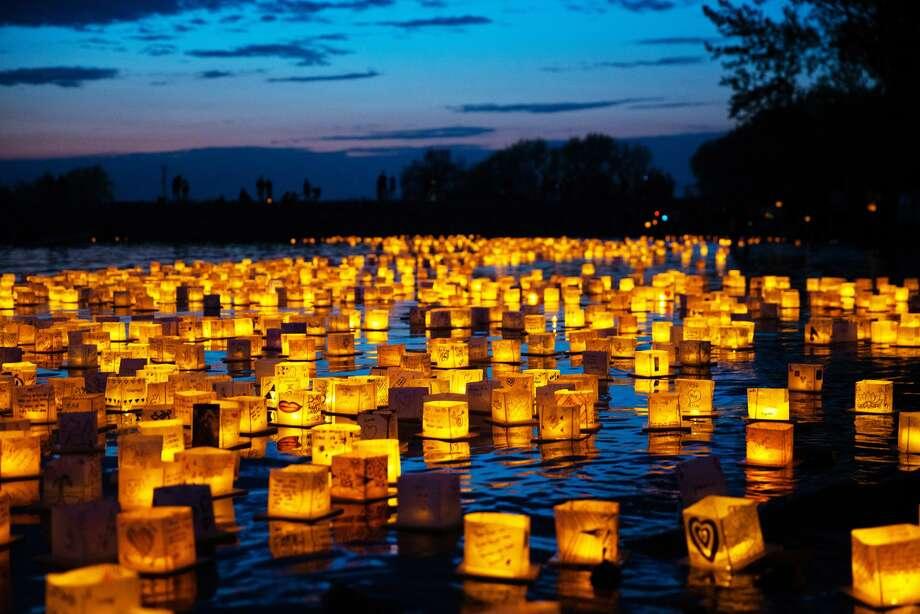 """Water Lantern Festival - multiple locations """"The Water Lantern Festival is all about connections. Magical nights in cities across the U.S. include food, live music and the beauty of thousands of lanterns adorned with letters of love, hope and dreams floating on the water,"""" USA Today says. Photo: Courtesy The Water Lantern Festival"""