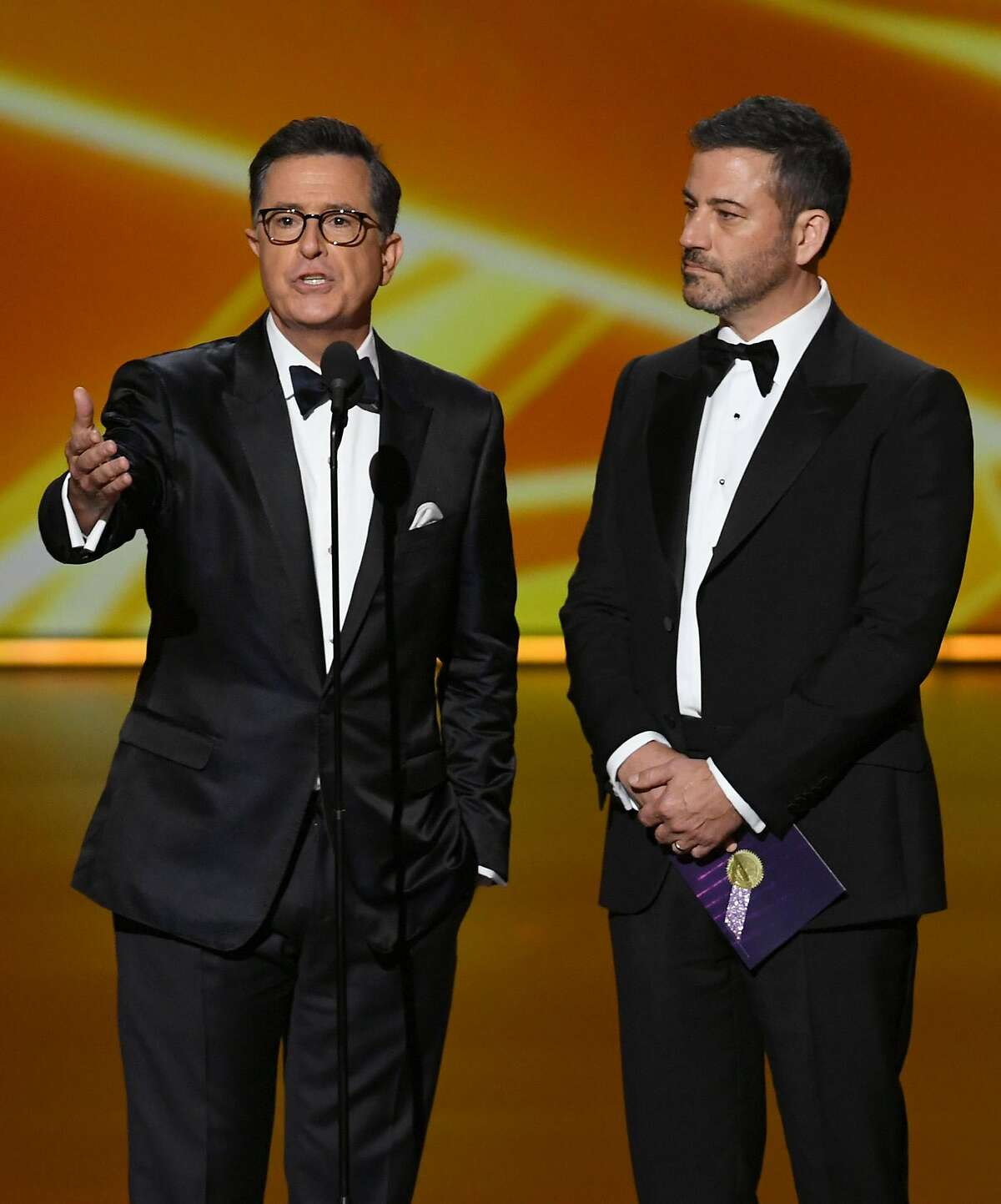 (L-R) Stephen Colbert and Jimmy Kimmel speak onstage during the 71st Emmy Awards at Microsoft Theater on September 22, 2019 in Los Angeles, California.