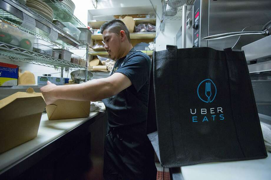 Grown used to inexpensive meal delivery, like UberEats? Get ready for a big change. Photo: Santiago Mejia / Special To The Chronicle