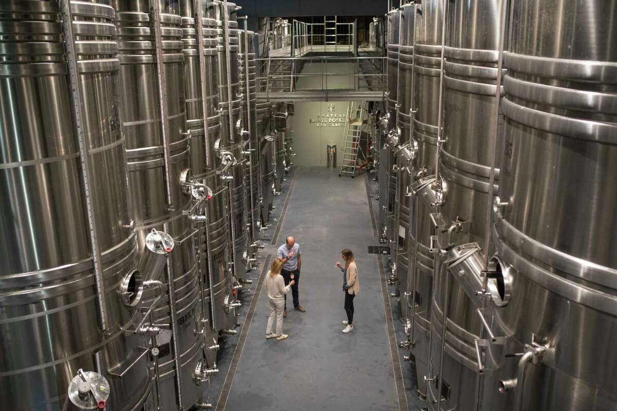 Winemakers taste rose in the production facility of the Chateau Sainte Roseline in the southern France region of Provence Friday Oct. 11, 2019. European producers of premium specialty agricultural products like French wine, Italian Parmesan and Spanish olives are facing Fridaya€™s U.S. tariff hike with a mix of trepidation and indignation at being dragged into a trade war over the fiercely competitive aerospace industry.(AP Photo/Daniel Cole)